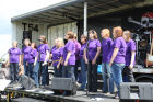 Local acappella group 'Rockapellas' on the stage entertaining the crowd